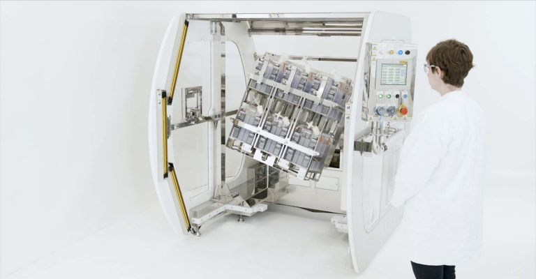 Scientist operates Corning® Automated Manipulator Platform