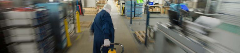 Worker moving quickly through manufacturing space