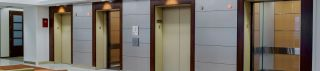 Four SnapCab® elevators share wall in lobby setting