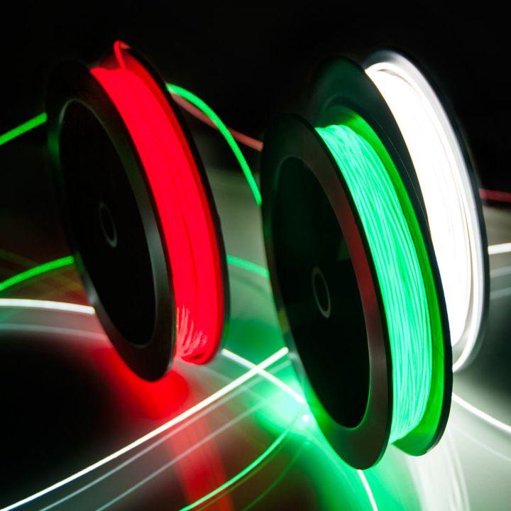 Spools of bright red, green, white Fibrance Light-Diffusing Fiber