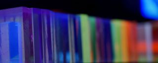 Blocks of colorful fluorescing glass in a row