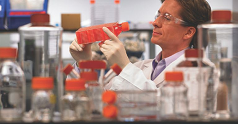 Scientist using Corning product in laboratory