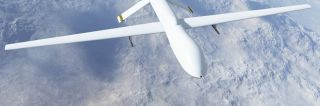 White drone flies over snowy, mountainous area