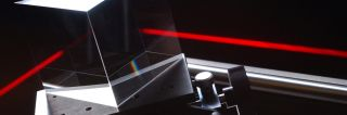 Red laser beam shows an optics component in action